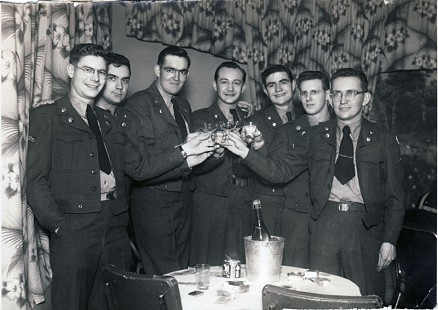 Delbert Lee (far left) celebrating the birth of his daughter with US Army friends while on active duty in Korea, February 13, 1951 © Pryor Center for Arkansas Oral and Visual History, University of Arkansas