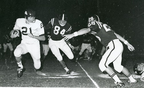 Jim Lindsey, number 21, playing for the Arkansas Razorbacks against the Texas Aggies © Pryor Center for Arkansas Oral and Visual History, University of Arkansas
