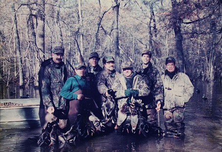 Jim Kelly, Mike Mahony (in green shirt), Warren Simpson, Emon A. Mahony Jr. (center), Madison Murphy, Witt Stephens, and Bobby Raney; near Stuttgart, Arkansas, duck season 1996-97 © Pryor Center for Arkansas Oral and Visual History, University of Arkansas