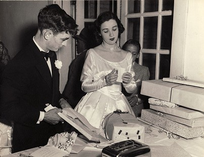 Tim and Dorothy Massanelli opening wedding presents at the Oakland Club; Pine Bluff, Arkansas, February 6, 1954 © Pryor Center for Arkansas Oral and Visual History, University of Arkansas