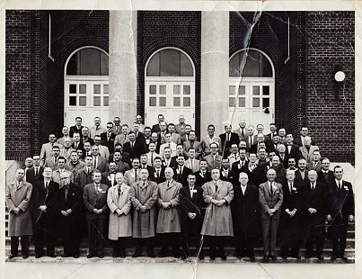 "Fourth degree Knights of Columbus in front of St. Joseph's Catholic Church on Initiation Day; Tim Massanelli (front row, 8th person from left in a black coat); a ""Grand Knight of the 3rd Degree"";  Pine Bluff, Arkansas, ca. 1958 (Note: the same church where Tim and Dorothy were married)  © Pryor Center for Arkansas Oral and Visual History, University of Arkansas"