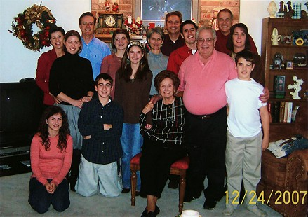 The Massanelli family, Christmas 2007, back row: Donna, Steve, Randy, Chip; middle row: Mallory, Megan, Laurie, Daniel; front row: Mary Kate, Jackson, Madeline (in headband), Dorothy, Tim, Parker © Pryor Center for Arkansas Oral and Visual History, University of Arkansas