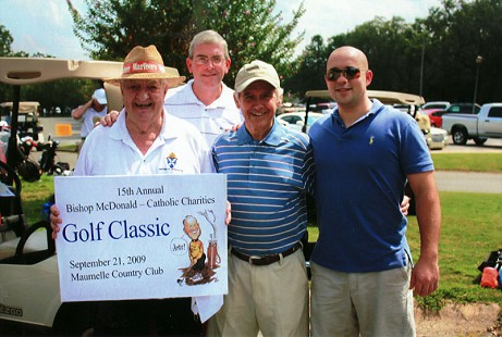 Tim Massanelli and his friends, Andy Smith, Doug Koenig, and Matt Garrison, at the 15th Annual Bishop McDonald Catholic Charities Golf Classic, Maumelle Country Club; Maumelle, Arkansas, September 21, 2009 © Pryor Center for Arkansas Oral and Visual History, University of Arkansas