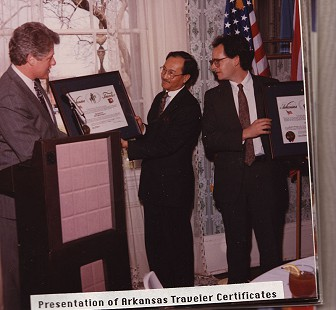 Bill Clinton presenting an Arkansas Traveler certificate to Ambassador Pibulsonggram © Pryor Center for Arkansas Oral and Visual History, University of Arkansas