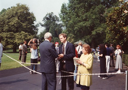 Jerry Maulden talking to Helen Thomas and a <i>Democrat</i> reporter outside the White House during the Clinton Administration &copy; Pryor Center for Arkansas Oral and Visual History, University of Arkansas