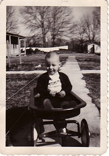 Young Tommy May sitting in a wagon © Pryor Center for Arkansas Oral and Visual History, University of Arkansas