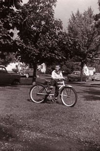 Young Tommy May standing with his bicycle © Pryor Center for Arkansas Oral and Visual History, University of Arkansas