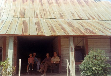 Tommy May family on the porch © Pryor Center for Arkansas Oral and Visual History, University of Arkansas