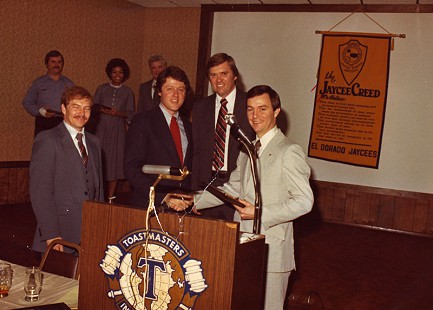 Tommy May (right) at a Jaycees meeting with Bill Clinton (second to left), 1980 © Pryor Center for Arkansas Oral and Visual History, University of Arkansas