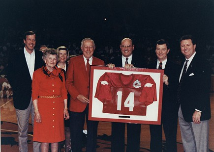 Tommy May (second to left) at center court with #14 football jersey © Pryor Center for Arkansas Oral and Visual History, University of Arkansas