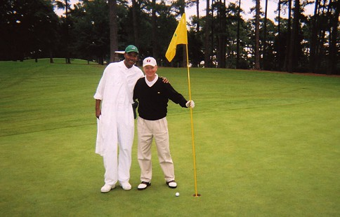 Tommy May with a caddie at Augusta National Golf Club © Pryor Center for Arkansas Oral and Visual History, University of Arkansas