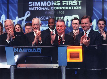 Tommy May (center) at NASDAQ © Pryor Center for Arkansas Oral and Visual History, University of Arkansas
