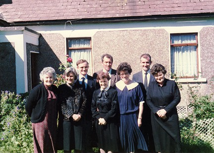 John McDonnell (back row, far right) with his siblings: (front row) Mary, Philomena, Carmel, Anne, and Margaret; (back row) Michael, Patrick, and John, 1986 © Pryor Center for Arkansas Oral and Visual History, University of Arkansas