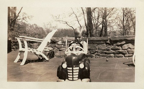 Hayden McIlroy in a pedal car © Pryor Center for Arkansas Oral and Visual History, University of Arkansas