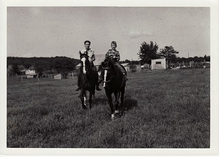 Hayden McIlroy, age 7, and his mother, Corin Kays McIlroy, on horseback © Pryor Center for Arkansas Oral and Visual History, University of Arkansas