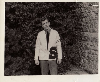 Hayden McIlroy in his high school letter sweater and tie © Pryor Center for Arkansas Oral and Visual History, University of Arkansas