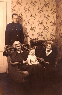Four generations: Archie Monroe (in US Air Force uniform); his grandmother, Lucy Kelso Couch; his son, Ark Monroe; and his mother, Alice Couch Monroe, in his grandmother's home © Pryor Center for Arkansas Oral and Visual History, University of Arkansas