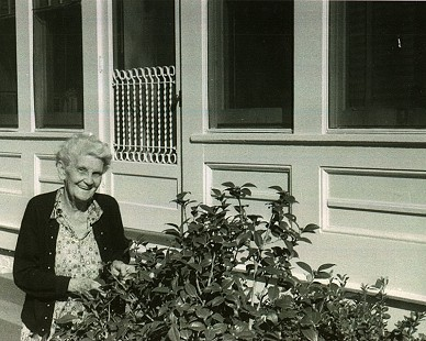 Alice Couch Monroe, mother of Archie Monroe, outside of house on N. Jackson St.; Magnolia, Arkansas, ca. 1950s © Pryor Center for Arkansas Oral and Visual History, University of Arkansas