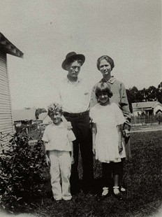 Dale Nicholson's mother, Rachel Mitchell (Nicholson), as a young girl, and her brother, Almond Haygood Mitchell, with their mother and step-father, Sarah Belle Leona Coon MItchell Clary and Bill Clary  © Pryor Center for Arkansas Oral and Visual History, University of Arkansas