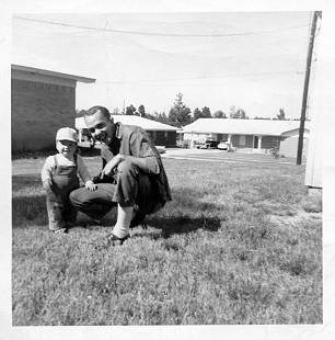 "Dale Nicholson with his son, Lawrence Dale ""Nick"" Nicholson Jr., ca. 1961 © Pryor Center for Arkansas Oral and Visual History, University of Arkansas"