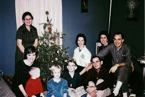 Dale Nicholson (far right) and his wife, Patsy, holding their daughter, Kelli (far left), with other family members at Christmas © Pryor Center for Arkansas Oral and Visual History, University of Arkansas