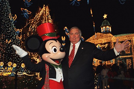 Jennings Osborne with Mickey Mouse at the Osborne Family Spectacle of Dancing Lights in Orlando, Florida © Courtesy of the Osborne family; http://www.facebook.com/pages/Jennings-Osborne/223719354333000