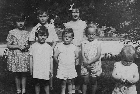 "Peggy Murphy (Parks) (front row, left) with her cousins: David Kelly, Natalie Murphy, and Joe Martin Murphy (far right); and her siblings: (back row, left to right) Mary Ellen Murphy, James ""Jimmy"" Ellis Murphy, and Jeanne Marie Murphy © Pryor Center for Arkansas Oral and Visual History, University of Arkansas"
