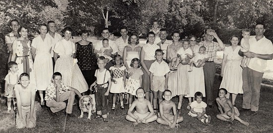 Peggy and Donald Parks (back row, left) at a family reunion with her parents, Eugene and Emelia Murphy (second couple from right), 1956 © Pryor Center for Arkansas Oral and Visual History, University of Arkansas