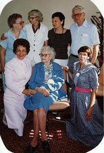 "Peggy Murphy Parks (front row, left) with her mother, Emelia Murphy, and her siblings (clockwise from left): Mary Ellen Clark, June Rooney Giles, Jeanne Marie Hicks, James ""Jimmy"" Ellis Murphy, and Betty Jane George © Pryor Center for Arkansas Oral and Visual History, University of Arkansas"