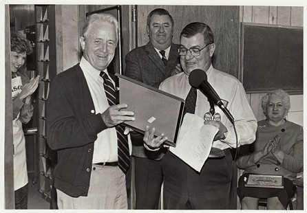 Sonny Payne receiving an award with his wife, Josephine (seated), and Jim Howe in background © Pryor Center for Arkansas Oral and Visual History, University of Arkansas