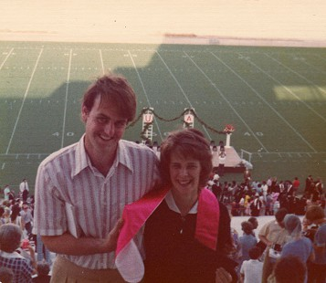Stanley and Charlene Reed at her graduation from the University of Arkansas, Fayetteville; Razorback Stadium, May 1974 © Pryor Center for Arkansas Oral and Visual History, University of Arkansas
