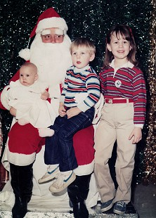 Stanley Reed's children, Anna, Nathan, and Haley, with Santa © Pryor Center for Arkansas Oral and Visual History, University of Arkansas
