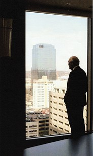 Doyle Rogers looking at the Rogers Building from the Excelsior Hotel; Little Rock, Arkansas, 2006 © Pryor Center for Arkansas Oral and Visual History, University of Arkansas