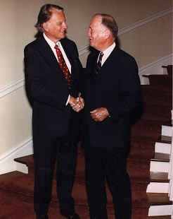 Doyle Rogers (right) shaking hands with Billy Graham at the Governor's Mansion, 1998 © Pryor Center for Arkansas Oral and Visual History, University of Arkansas