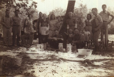 Charles Scharlau (far right) at a picnic at Lake Norfork, near Mountain Home, Arkansas © Pryor Center for Arkansas Oral and Visual History, University of Arkansas