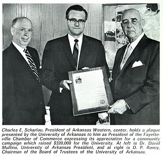 Charles Scharlau, president of the Fayetteville Chamber of Commerce, receiving a plaque from David Mullins, University of Arkansas System president, and D. P. Raney, chairman of the UA Board of Trustees, in appreciation for a community campaign that raised $320,000 for the university (photo from Arkansas Western Gas 1968 annual report) © Pryor Center for Arkansas Oral and Visual History, University of Arkansas