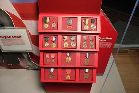 Clyde Scott's medals on display at the University of Arkansas, May 2010 © Pryor Center for Arkansas Oral and Visual History, University of Arkansas