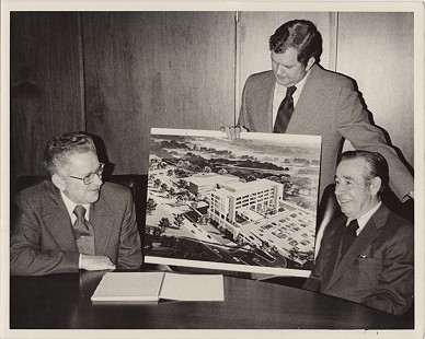 Curtis Shipley (center), holding an artist's rendering of the Washington Regional Medical Center expansion, with Joe McKim (left) and Hal Douglas, 1975 © Pryor Center for Arkansas Oral and Visual History, University of Arkansas