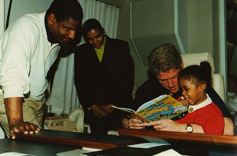 Rodney Slater with his wife, daughter, and President Clinton on Air Force One © Pryor Center for Arkansas Oral and Visual History, University of Arkansas