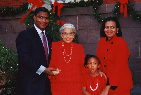Rodney Slater with Rosa Parks, his daughter, Bridgette, and wife, Cassandra, at Christmas © Pryor Center for Arkansas Oral and Visual History, University of Arkansas