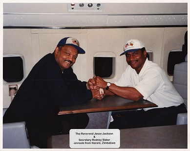 Rev. Jesse Jackson and Rodney Slater on a plane en route to Zimbabwe © Pryor Center for Arkansas Oral and Visual History, University of Arkansas