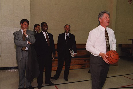 Rodney Slater with President Bill Clinton shooting basketball in a gymnasium  © Pryor Center for Arkansas Oral and Visual History, University of Arkansas