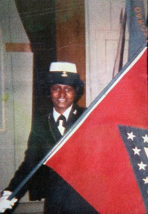 Carolyn Smith-Williams in US Navy uniform with the Arkansas flag © Pryor Center for Arkansas Oral and Visual History, University of Arkansas
