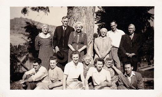 Vic Snyder's family: (back row, from left) Kate, Grandpa Fred Bloomingcamp, Emma, Grandma Bloomingcamp, Charles, and Ed; (front row, from left) Mike, Gertie, Bee, Dell, Marjorie, Elsie, and Don; at Bogus Bloomingcamp Ranch; 1946 © Pryor Center for Arkansas Oral and Visual History, University of Arkansas