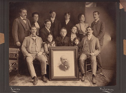 David Solomon's family: (top row, left to right) Meyer Cook, Ella Solomon Cook, Lafe Solomon, Henry Solomon, Sophie Solomon, Joe Solomon; (middle row) Dave Solomon Sr. (father), Sarah Solomon; (front row) Louis Solomon, Ruth Cook, Pauline Solomon (paternal grandmother), Myrtle Solomon, Phillip Solomon; portrait, Moses Solomon (paternal grandfather) © Pryor Center for Arkansas Oral and Visual History, University of Arkansas