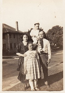 David Solomon with his mother, Pauline Elkas Solomon; father, David Solomon Sr.; and sister, Hannah Pauline Solomon, at 727 Poplar, Helena, Arkansas © Pryor Center for Arkansas Oral and Visual History, University of Arkansas