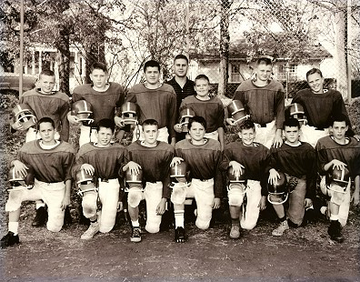 Marty Steele (1st row, center) and the St. Joseph's Catholic School football team, Fayetteville, Arkansas                              © Pryor Center for Arkansas Oral and Visual History, University of Arkansas