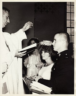 Marty Steele and Cindy Bayliss Steele at their wedding, with Chaplain John Joseph O'Connor presiding; Quantico, Virginia, 1967 © Pryor Center for Arkansas Oral and Visual History, University of Arkansas