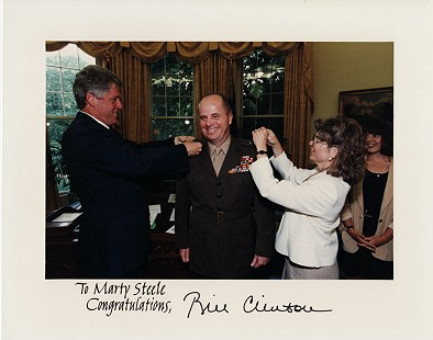 President Bill Clinton and Cindy Steele pin the new rank of brigadier general on Colonel Marty Steele in the Oval Office, 1993 © Pryor Center for Arkansas Oral and Visual History, University of Arkansas