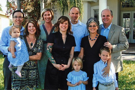 Marty Steele (right) with his family: (from left) son-in-law, Carlos; granddaughter, Raquel; daughter, Diane; daughter-in-law, Natalie; daughter, Deborah; son, David; wife, Cindy; (in front) granddaughter; grandson, Matthew © Pryor Center for Arkansas Oral and Visual History, University of Arkansas